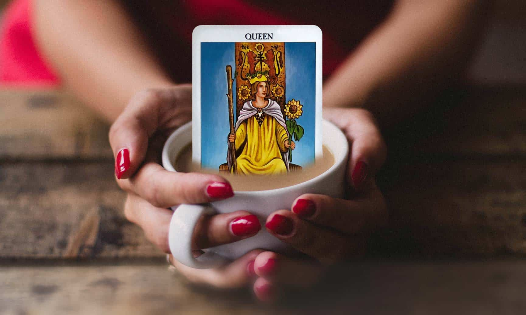 Hands holding coffee cup with tarot card